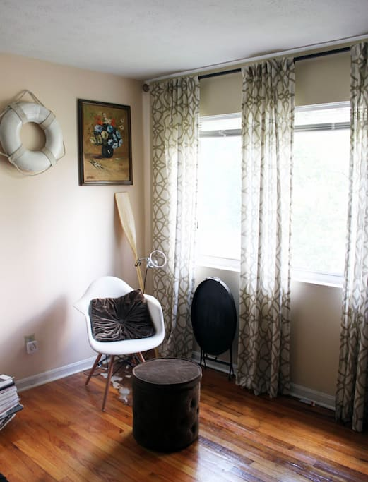 sitting area with ottoman and butler's tray/desk for laptop/work or meals.  lots of sun.
