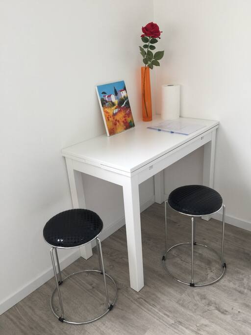 the table can become larger if you would like to work with your computer.