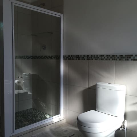 Brand new light bathroom with shower and bath