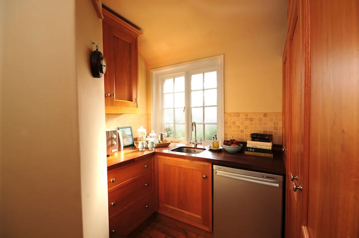 the nicely equipped kitchenette and dressing area with tasty treats included