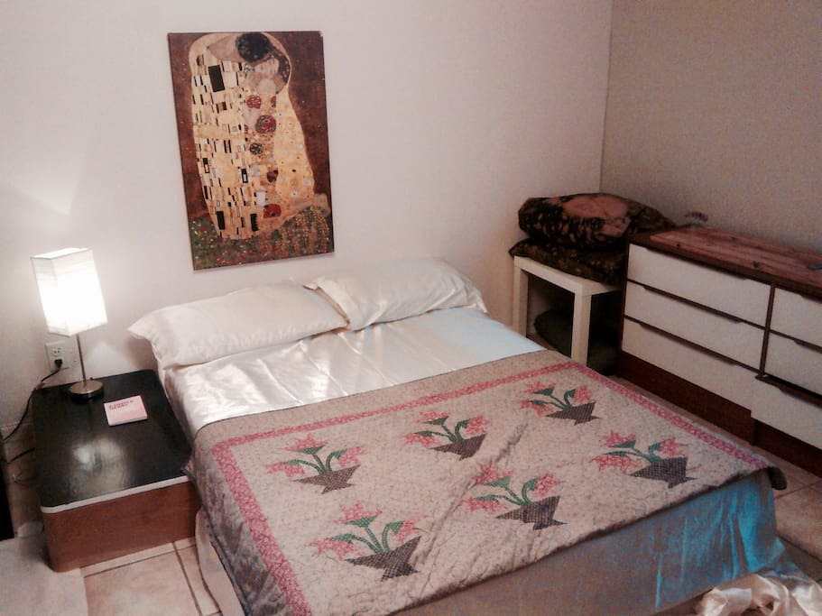 Large bedroom with double bed and air conditioning.