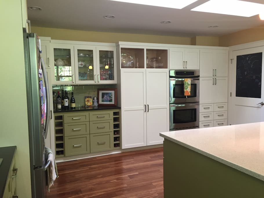 Huge kitchen with giant island--great for entertaining Or for kids to eat in while adults eat in Living room (a sliding door seals off the kitchen from the living room).
