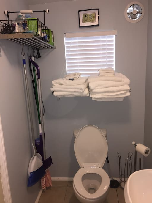 Full bathroom with  cleaning supplies and toiletries. 8 Sets of towels.