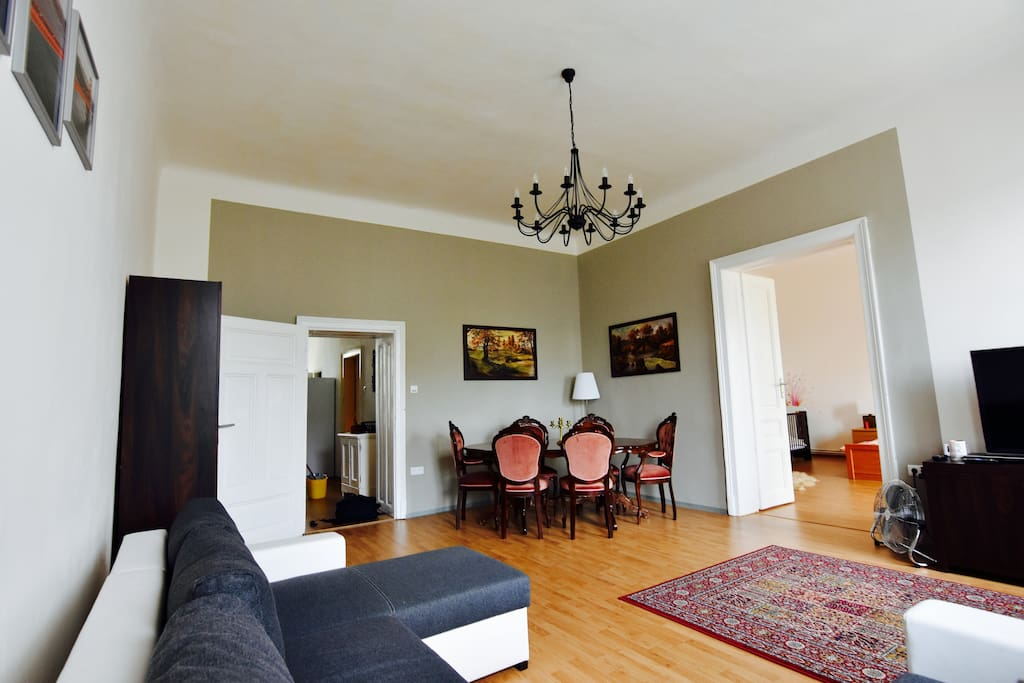 Big living room with table and chairs