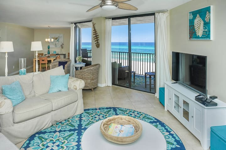 Pottery Barn slip covered sofas, wicker furniture with neutral colors furnish this ocean front home.