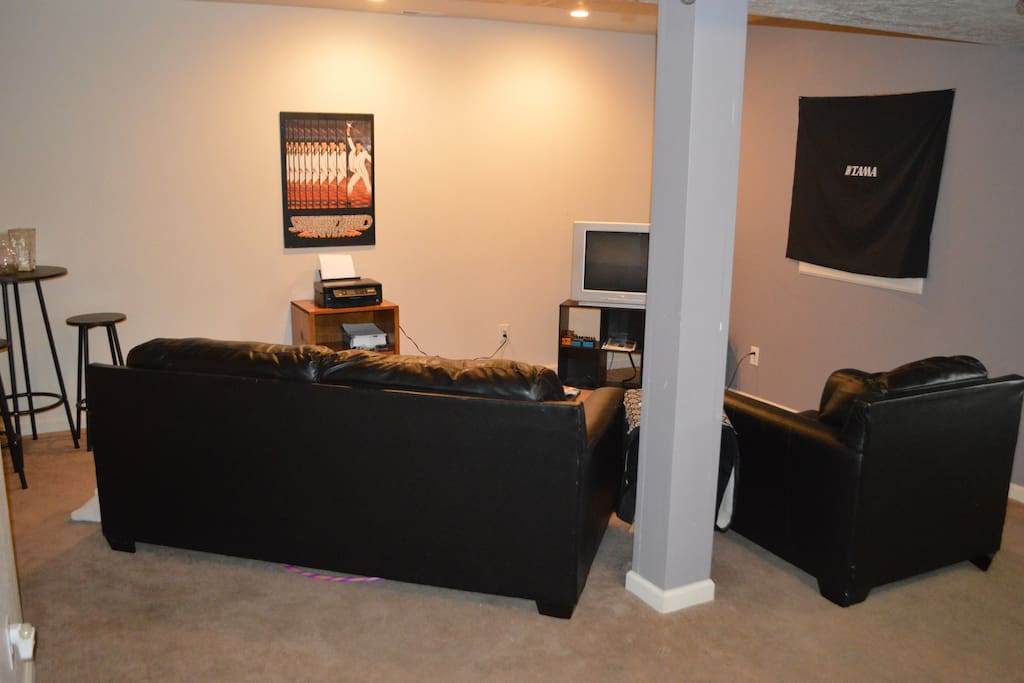 lounge section of basement with DVD player and movies.
