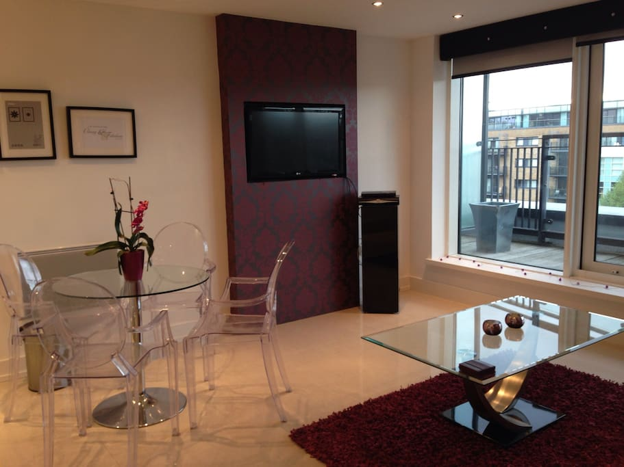 Living room with dining table and sky TV & DVD player