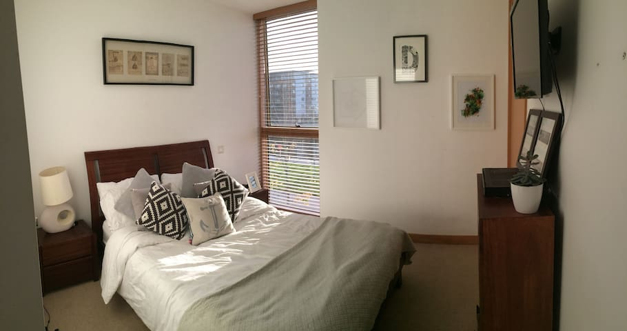 """Ensuite bedroom, canal view with 32"""" TV on wall connected to digital TV"""