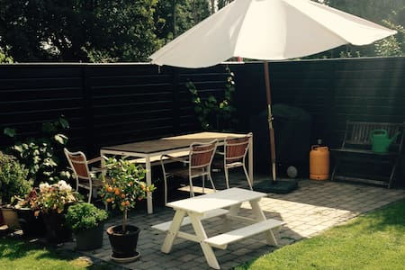 Our house is 102 m2 + 60m2 basement and perfect for family with children, next to the green areas of Utterslev mose. Just 5 km from Copenhagen in a quiet and friendly neighborhood. 500m from Søborg Hovedgade shopping street with good restaurants.
