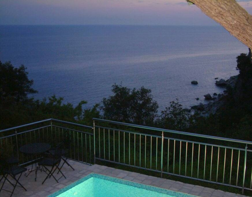 Romance at night with the see view and light in the swimming pool