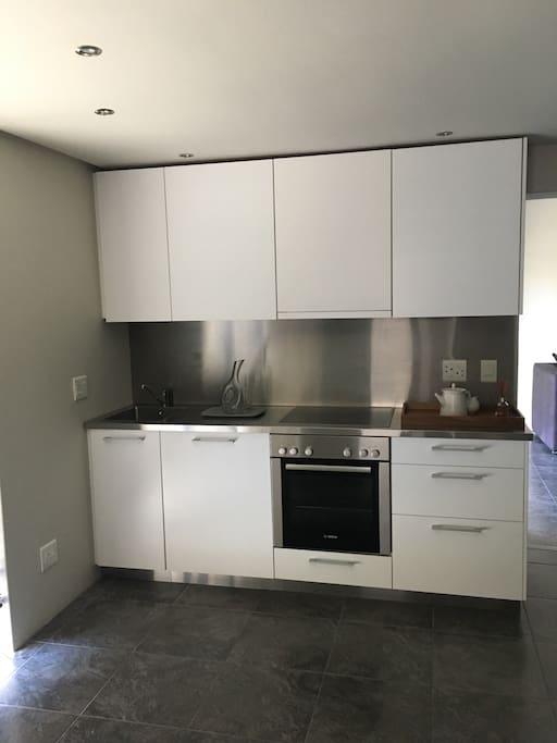 New fully equipped kitchen with washing machine , fridge and coffee machine