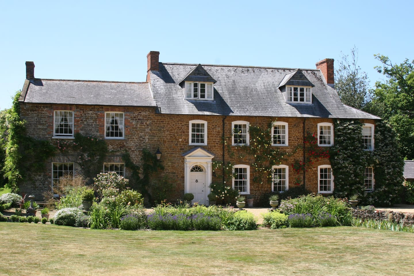 Georgian Style Old  Rectory set in 10 acres of land with medieval pond, swimming pool and mature garden.