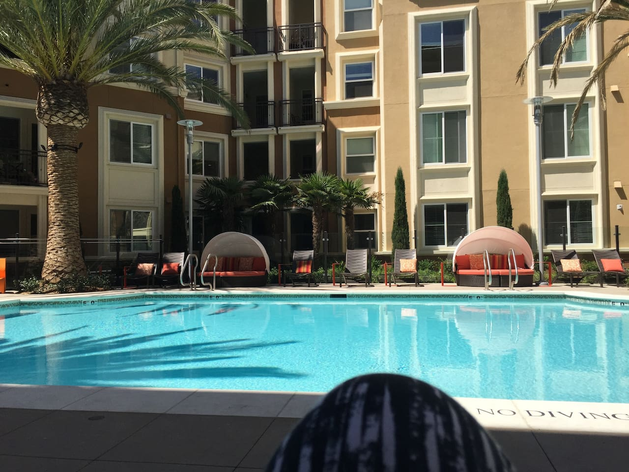 Community Pool with 2 grills, fire pit, and multiple lounge areas, free wi-fi