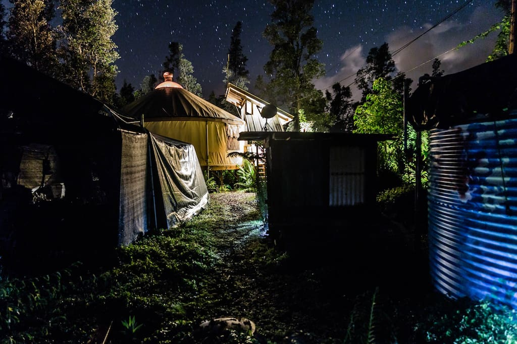 Night side view of yurt + stars above.
