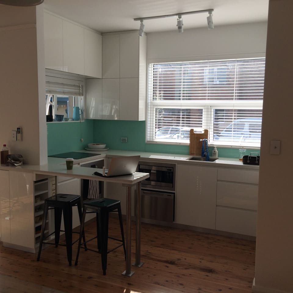 Large kitchen with breakfast bar and dishwasher