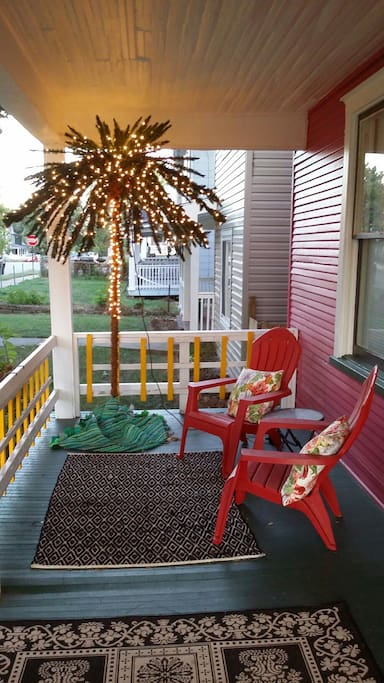 Left Side of Front Porch with lit Palm Tree