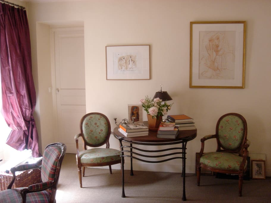 Sunny Living/Dining room with 3 typical French windows