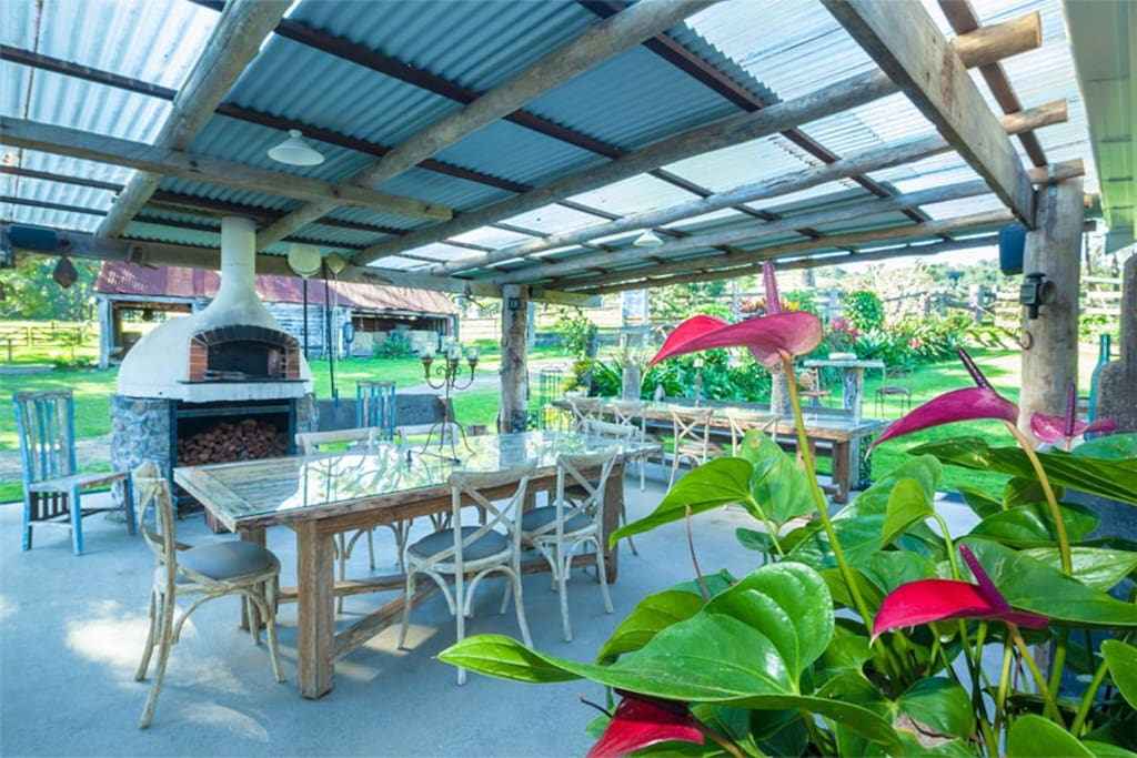 covered outdoor area with pizza oven