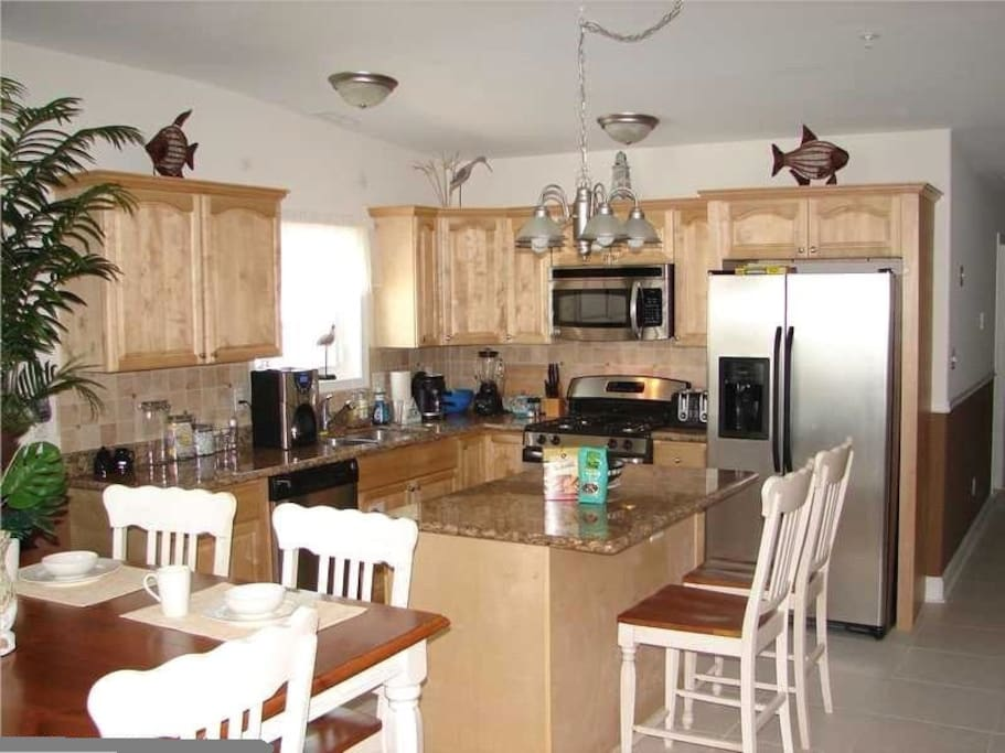 Well stocked kitchen with stainless appliances, granite counters, and island seating. Well designed for preparing and enjoying family meals and snacks together.