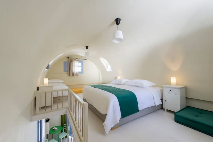 The loft bedroom in the vault is a typical Santorinian architecture characteristic.