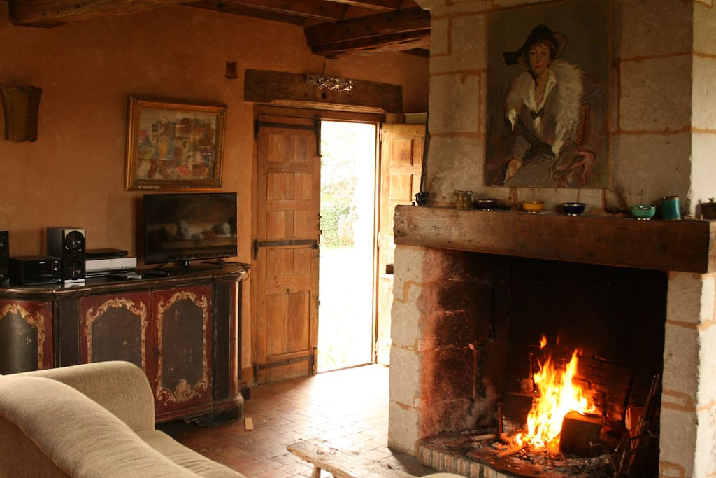 One of the three living rooms, with large fireplace and TV