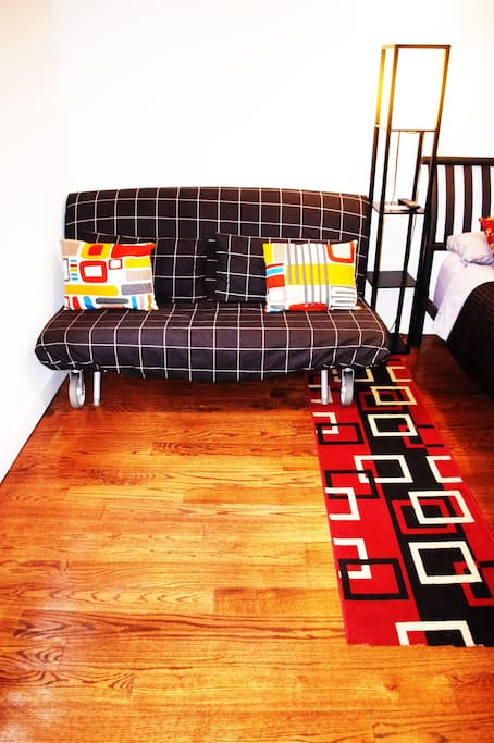 Futon easily rolls open to a full size bed, and rolls back closed to save space
