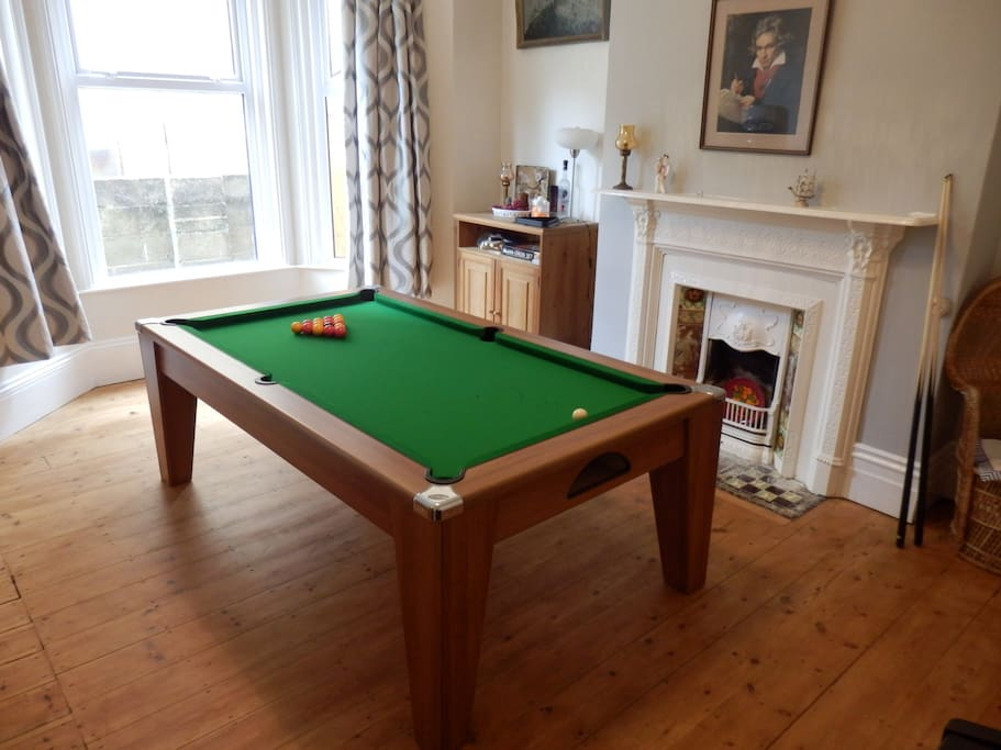 7' by 4' pool table with dining top and table tennis top. All bats, balls, cues, chalk provided. Yamaha piano in the corner.