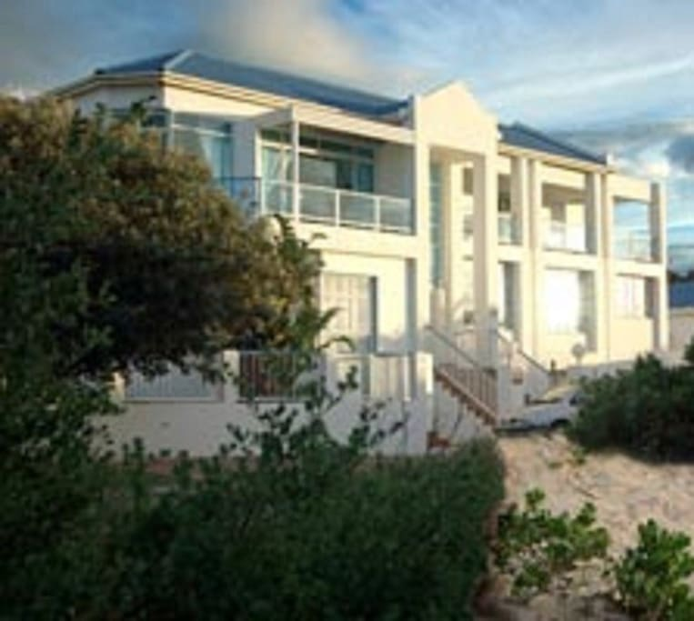 A Villa de Mer is situated on the beach front.