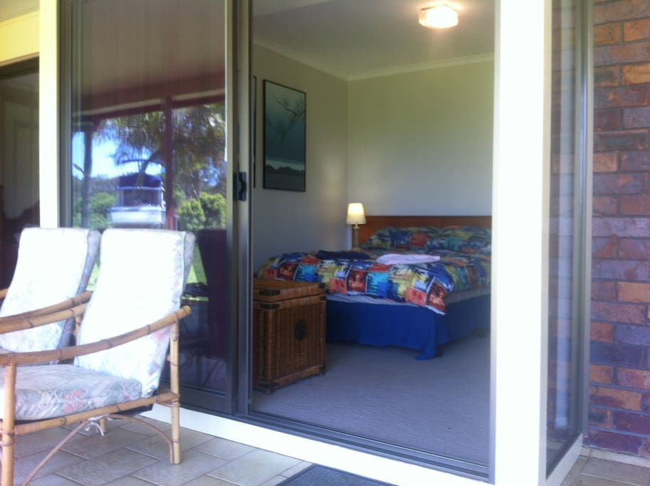 Comfortable double bedroom and sunny veranda.