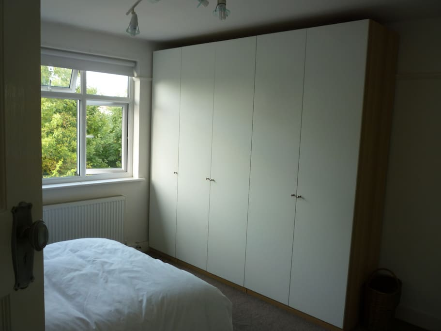 Massive amount of free wardrobe space with drawers, shelves, hangers etc.