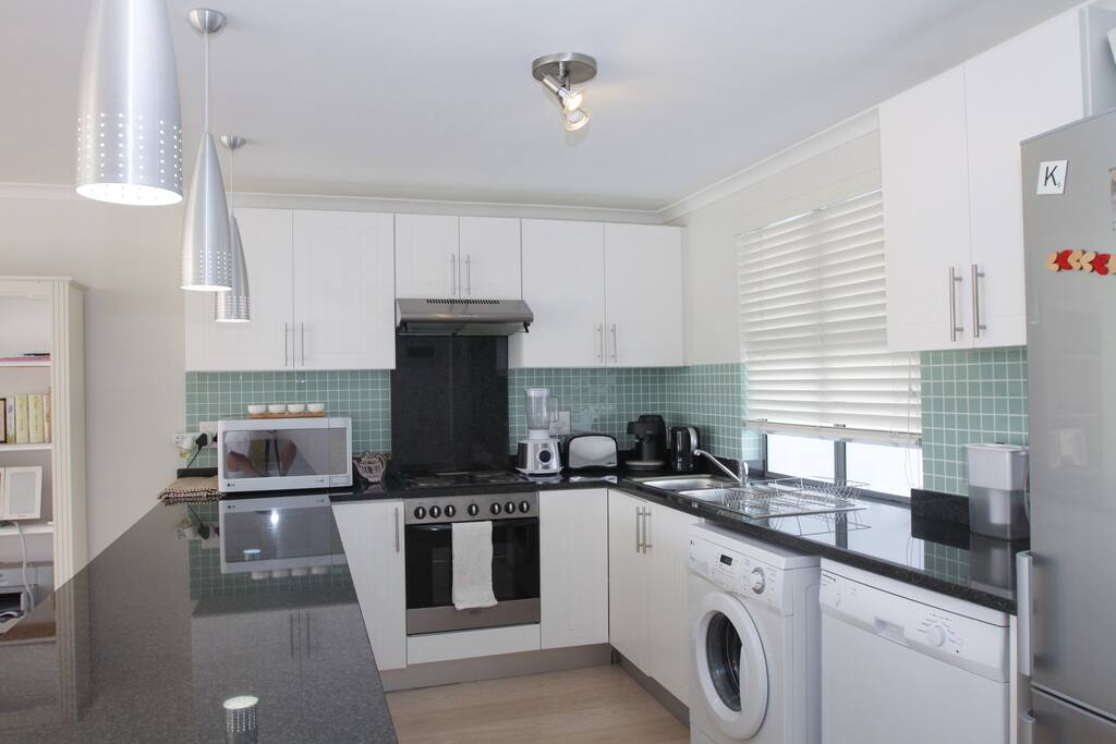 Spacious modern flat the rondebosch apartments for rent for Kitchen appliances cape town