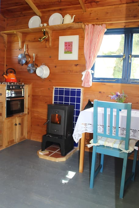 Cozy Woodburning stove. Vintage style kitchen and accesories.
