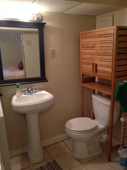 Basement half bath with washer and dryer