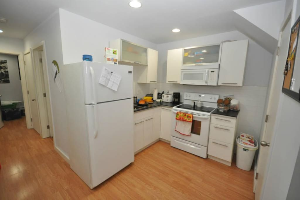 Full sized kitchen with oven, microwave and fridge