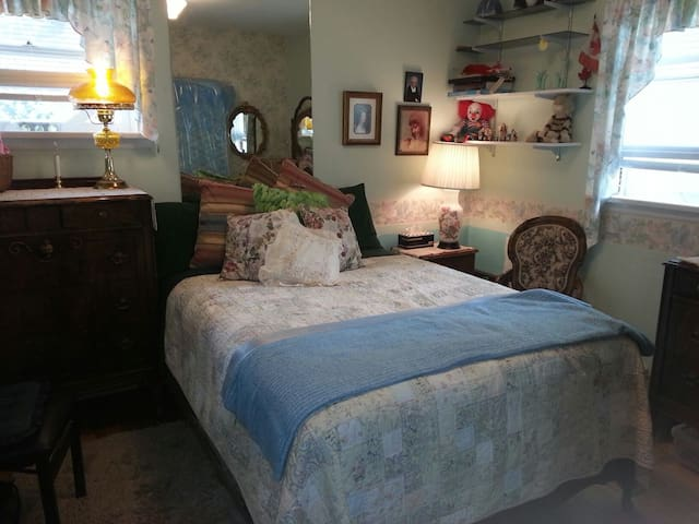 A cosy comfortable room with antique furniture and a new double bed mattress.