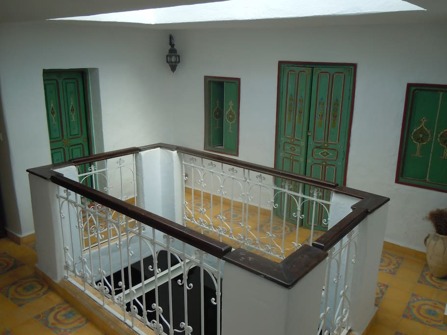 First floor, balcony with bedrooms leading off