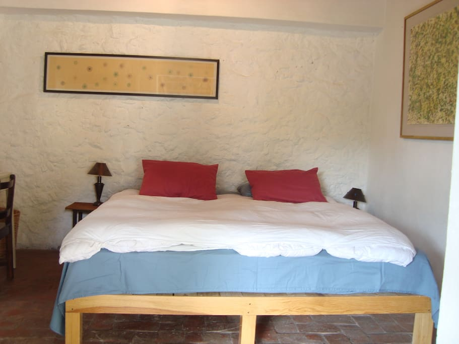 Room with kingsize bed. All rooms open to the garden.