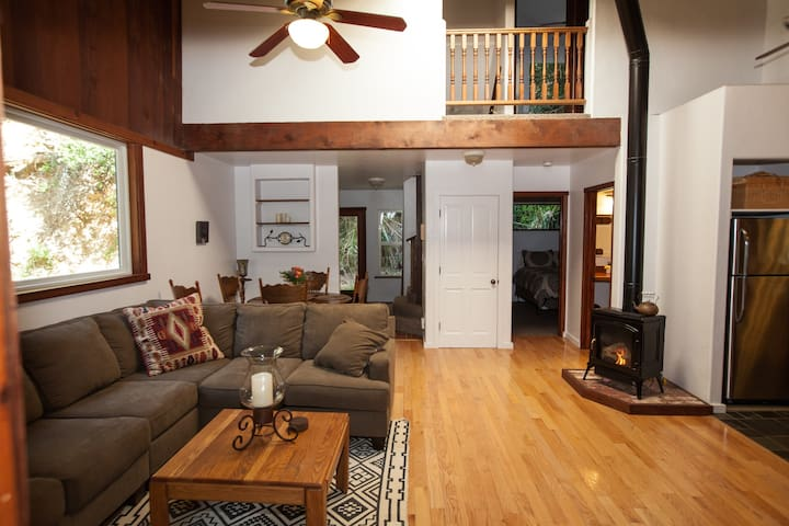View of great room as you walk in the front door.  Propane fireplace keeps things cozy - and no mess!