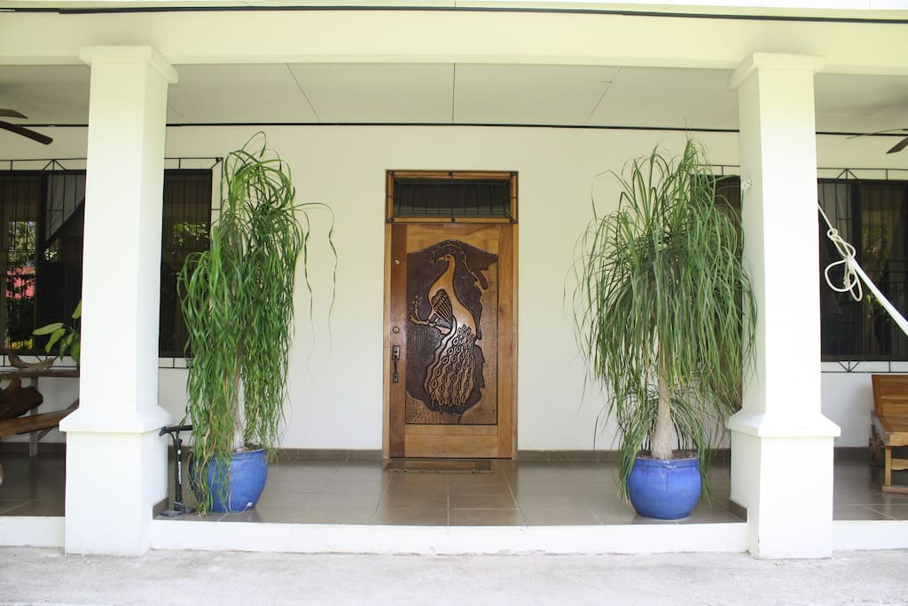 A beautiful, hand-carved front door will welcome you home each day.