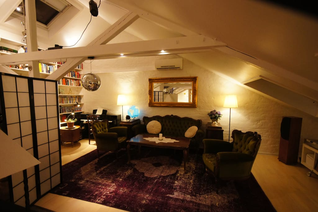 Cozy seating area - including disco ball and piano