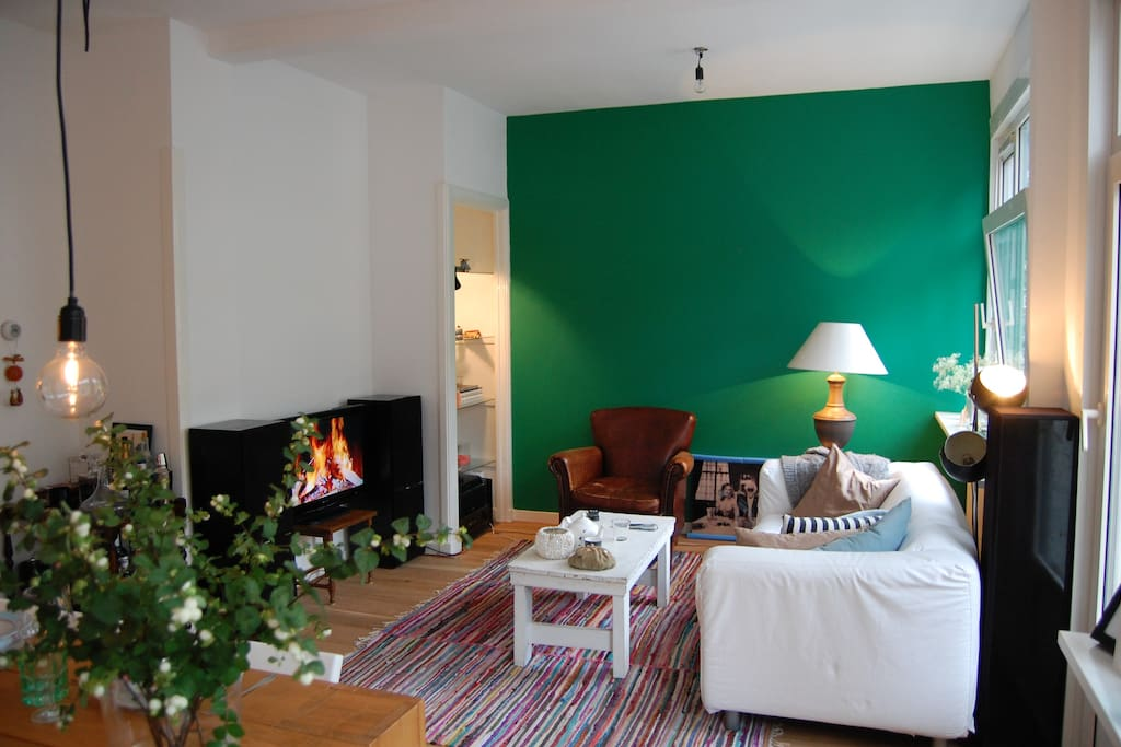 Bright, cosey and warm living room with beautiful old leather chair.
