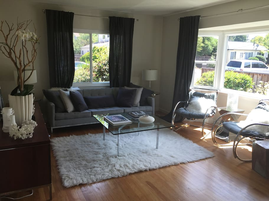 Grey woll Knoll Sofa, Authentic ies Van Der Rohe chairs, and flokati rug complete this modern designer's dream furniture.