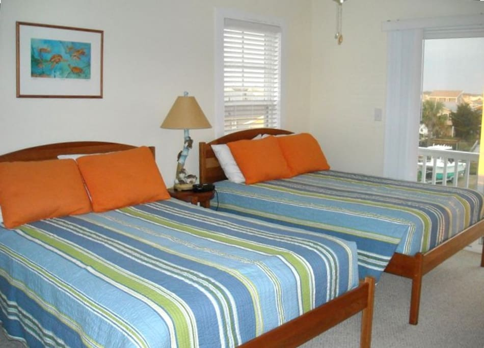 2nd floor street-side room with small private balcony and 2 Full size beds.