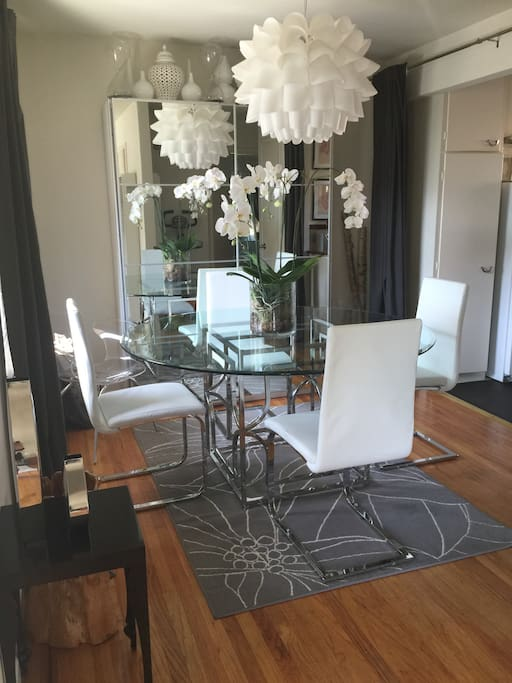 Dining room doubles as an office, just slide the glass doors open for access to office supplies and printer.