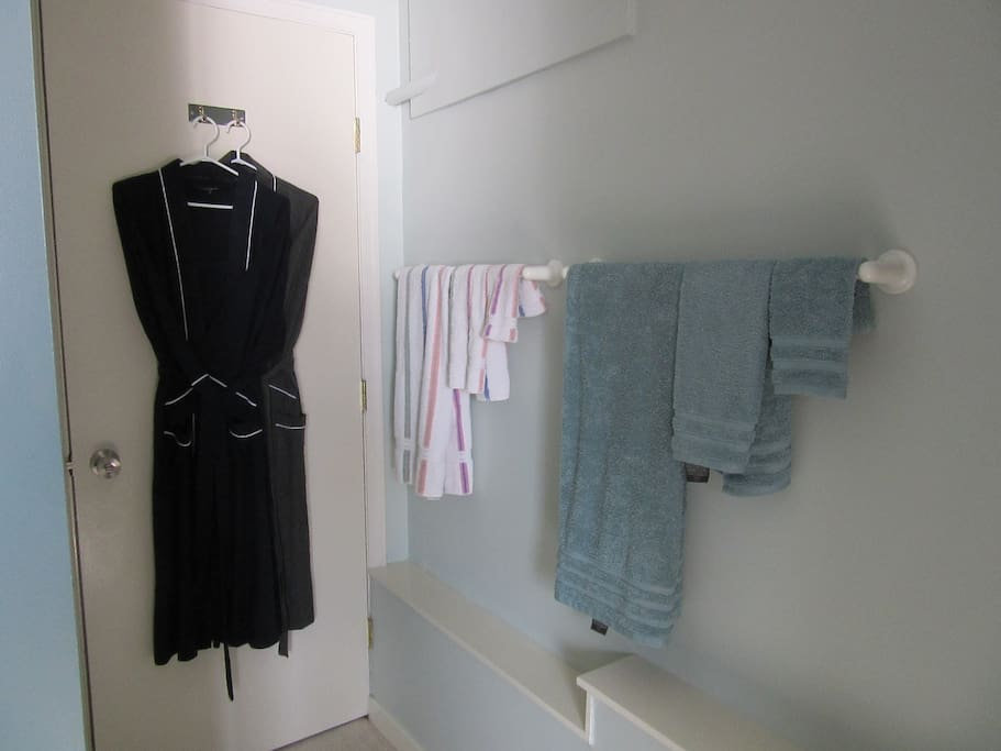 Robes, towels & hair dryer for you to use.