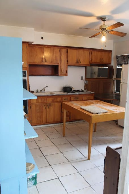 Fully equipped kitchen with cooking and eating utensils