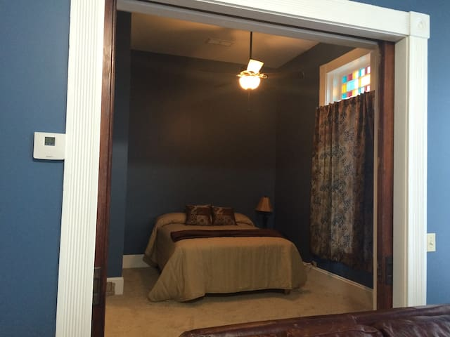 Pocket doors can separate the bedroom from the living area.