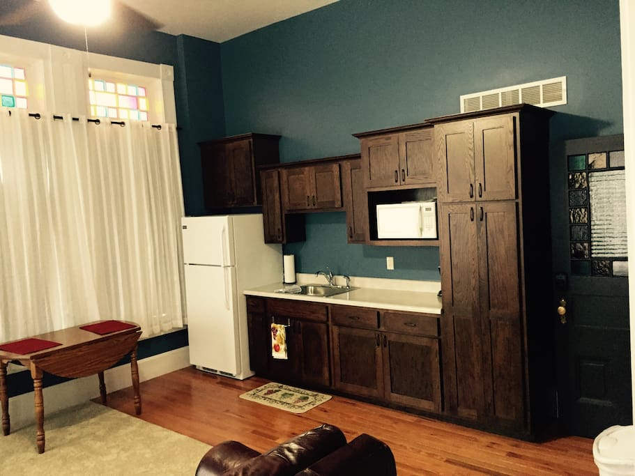 Kitchenette includes full fridge, microwave, toaster oven, coffee maker, cups, plates, utensils, etc.