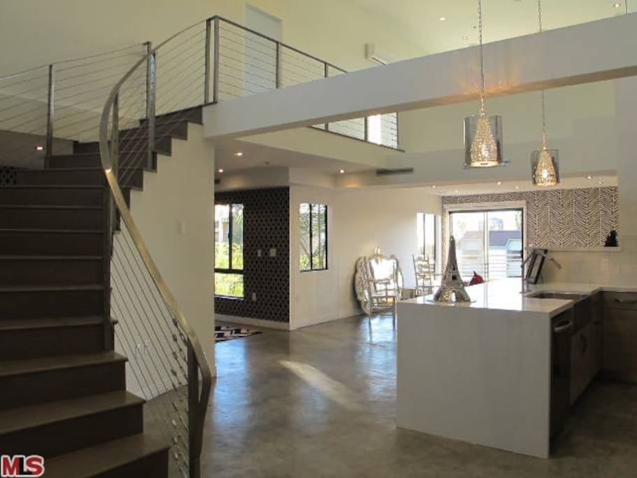 Impressive Entryway with 20' ceilings and  winding staircase; entire house has built in surround sound