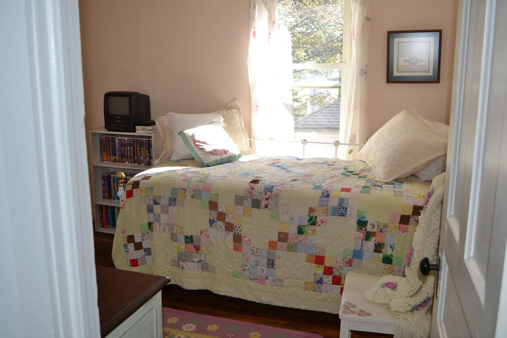 Twin bed with trundle makes a cozy room.